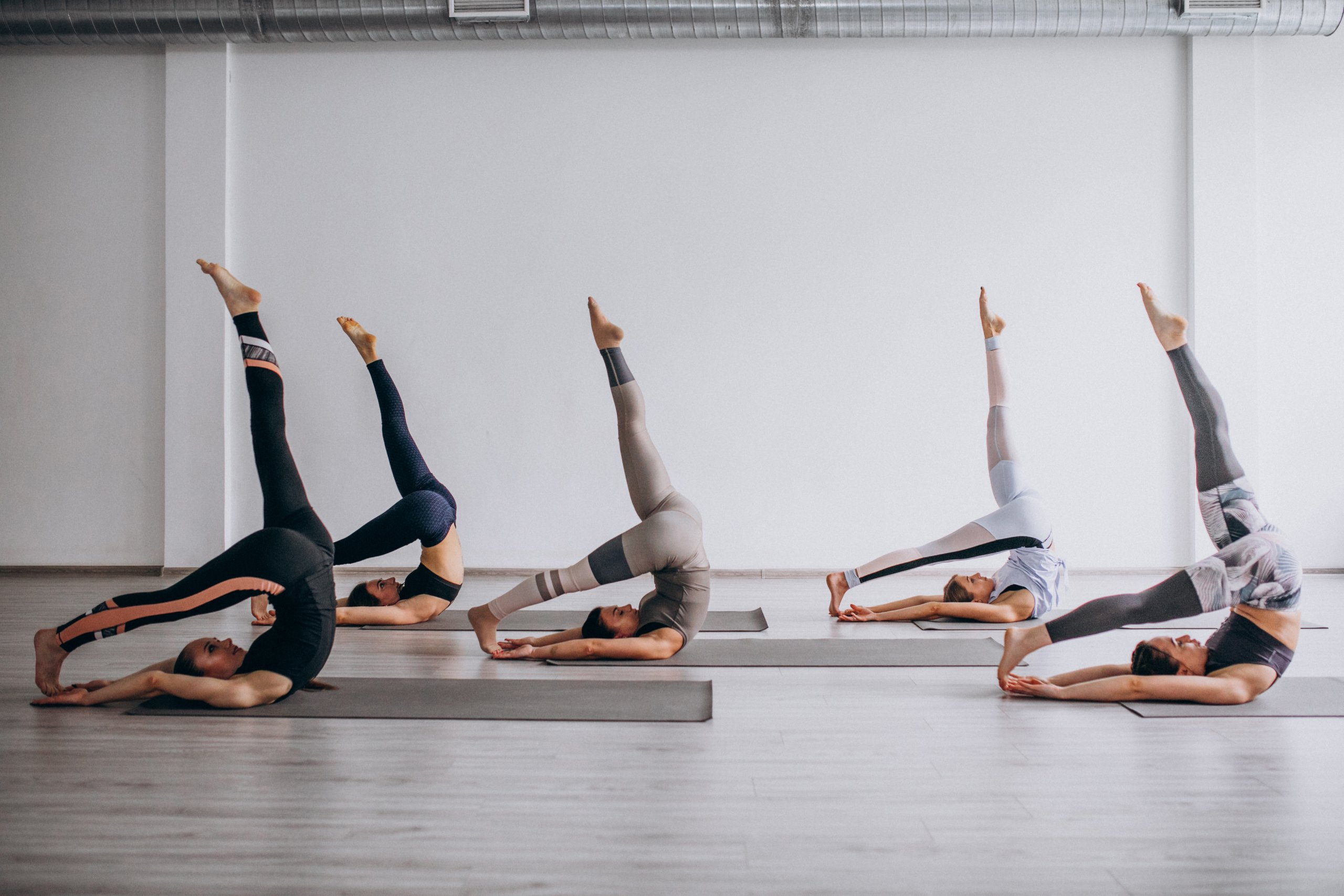 Yoga group classes inside gym scaled - wondercise   online fitness academy   official website
